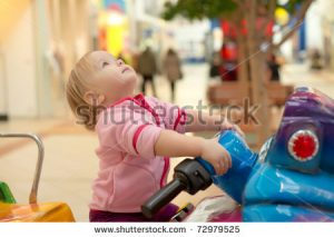 stock-photo-young-adorable-baby-ride-on-baby-motorcycle-look-up-out-01